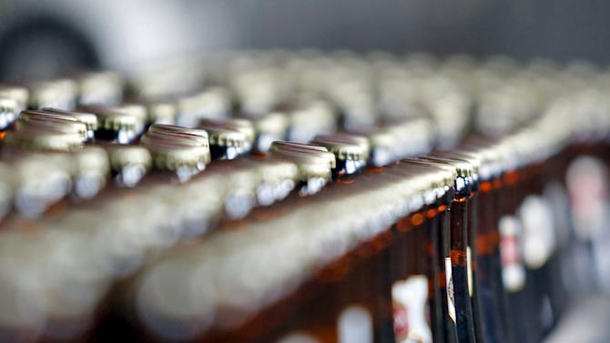 Bottles beer move along a production line at a Sabeco factory in Hanoi, Vietnam