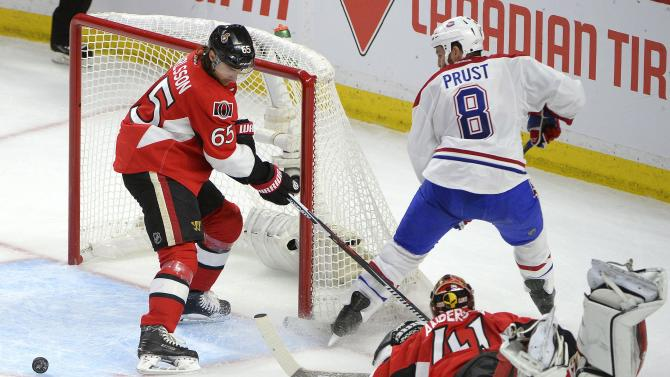 Ottawa Senators' Erik Karlsson (65) guards the net from Montreal Canadiens' Brandon Prust (8) as Ottawa Senators' Craig Anderson (41) falls outside his crease during the first period of Game 6 of a first-round NHL hockey playoff series Sunday April 26, 2015, in Ottawa, Ontario. (Justin Tang/The Canadian Press via AP)   MANDATORY CREDIT