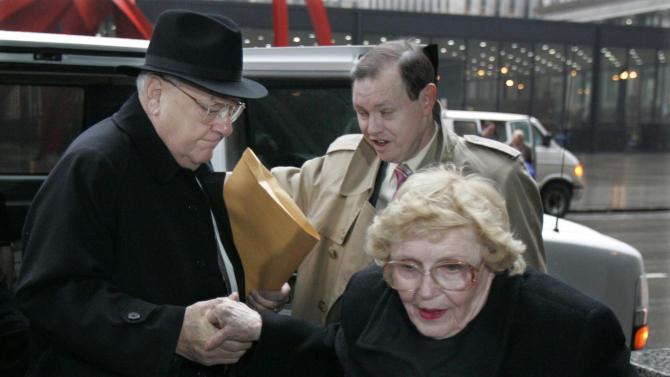 FILE - In this March 6, 2006 file photo, former Illinois Gov. George Ryan, left, arrives at federal court in Chicago for his racketeering and corruption trial with his wife, Lura Lynn, front, and chief defense counsel Dan K. Webb. He was convicted of racketeering and fraud charges in April 2006. Ryan, who reported to prison in November 2007, is scheduled to be released from a Terre Haute, Ind., prison Wednesday, Jan. 30, 2013, and enter a halfway house in Chicago. Both his wife and a brother died while he was in prison. (AP Photo/M. Spencer Green, File)