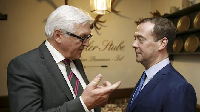 German Foreign Minister Frank-Walter Steinmeier speaks to Russian Prime Minister Dmitry Medvedev during a meeting on the sideline the Munich Security Conference in Munich