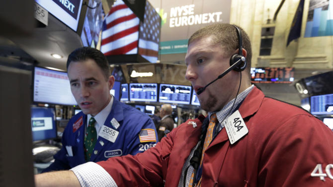 Specialist Jason Hardzewic, left, and trader Ryan Falvey work on the floor of the New York Stock Exchange Friday, Dec. 21, 2012. Stocks opened sharply lower Friday on Wall Street after House Republicans called off a vote on tax rates and left federal budget talks in disarray 10 days before sweeping tax increases and government spending cuts take effect. (AP Photo/Richard Drew)
