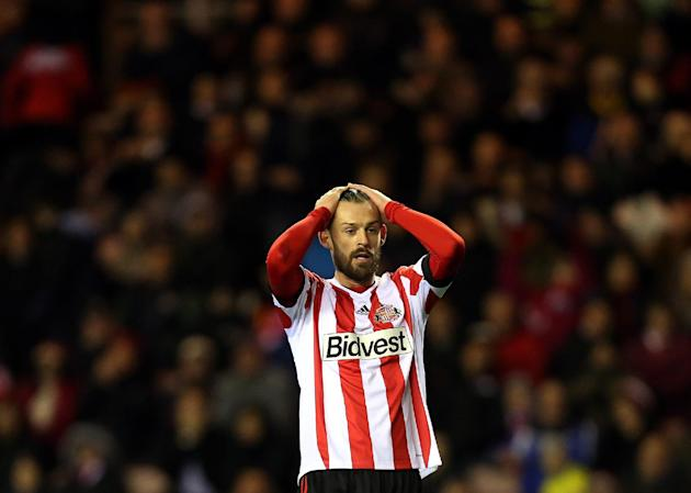 Sunderland's Steven Fletcher stands dejected after being defeated by Tottenham Hotspurs at the end of their English Premier League soccer match at the Stadium of Light, Sunderland, England, Saturd