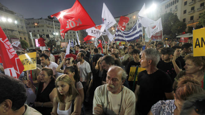 Supporters of Greece's radical left-wing Syriza party take part to a rally at Aristotelous square in Thessaloniki, Friday, June 15, 2012. Greece faces crucial national elections on Sunday, that could ultimately determine whether the debt-saddled, recession bound country remains in the eurozone. (AP Photo/Dimitri Messinis)