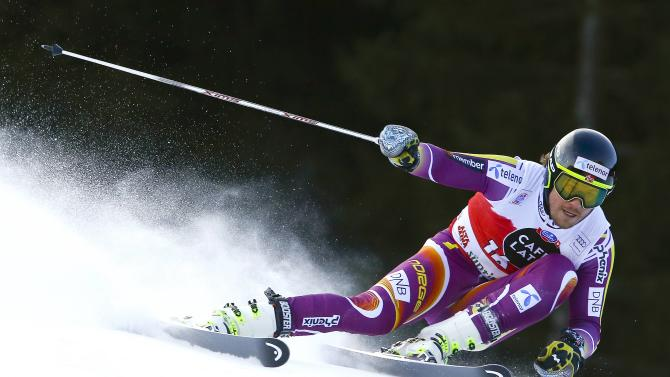 Jansrud of Norway clears a gate during the men's World Cup Giant Slalom skiing race in Alta Badia