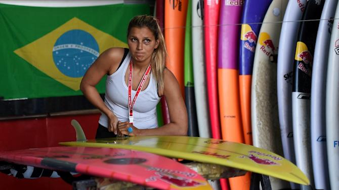 Brazilian surfer Maya Gabeira preps her board before a surf session at Praia do Norte in Nazare, central Portugal