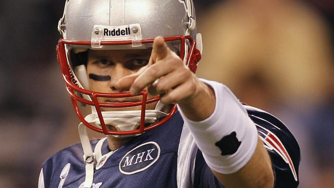 New England Patriots quarterback Tom Brady points toward the sidelines before the NFL Super Bowl XLVI football game against the New York Giants, Sunday, Feb. 5, 2012, in Indianapolis. (AP Photo/Paul Sancya)