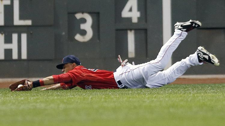 Boston Red Sox's Mookie Betts makes the catch on a fly-out by Seattle Mariners' Kendrys Morales during the fourth inning of a baseball game in Boston, Friday, Aug. 22, 2014. (AP Photo/Michael Dwyer)