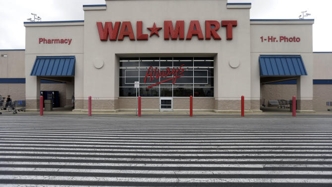 Wal-Mart cuts profit outlook on shopper worries