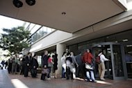Individuals line up to enter the United States Courthouse in San Jose, California, to watch Apple and Samsung face each other in a patent infringement case on July 30. Lawyers for Apple and Samsung debated the differences between copying and honest competition as opening arguments were held Tuesday in a huge patent trial involving the two tech giants