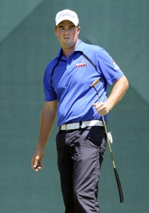Marc Leishman, of Australia, watches his putt on the ninth hole during the final round of the Travelers Championship golf tournament in Cromwell, Conn., on Sunday, June 24, 2012. Leishman shot a final round 62 to win the tournament at 14-under par. (AP Photo/Fred Beckham)