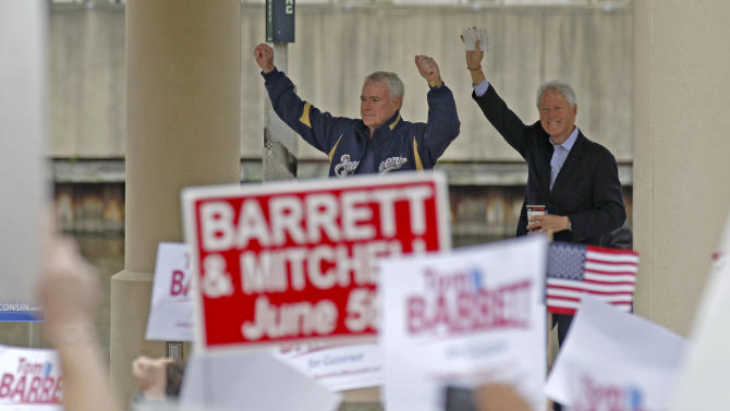 Former President Bill Clinton, right, and Democratic candidate for Governor Tom Barrett are welcomed by supporters at a recall election rally Friday, June 1, 2012, in Milwaukee. Clinton urged hundreds of Wisconsin Democrats to vote out Republican Gov. Scott Walker in next weekís recall election because he refused to govern through compromise and honest negotiation.  (AP Photo/Jeffrey Phelps)