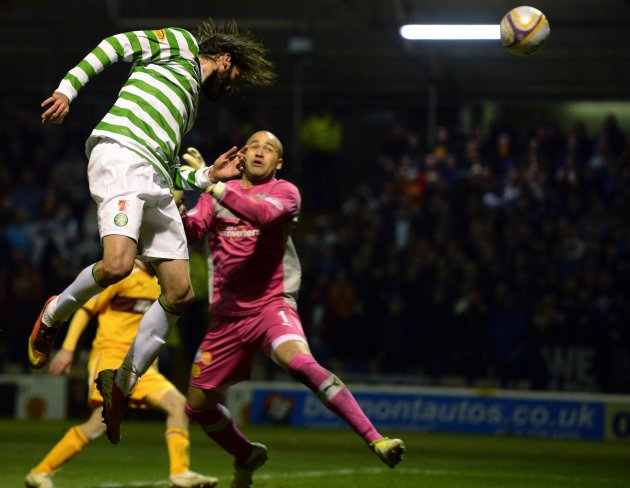Celtic's Georgios Samaras scores against Motherwell during their Scottish Premier League soccer match at Fir Park Stadium in Motherwell, Scotland