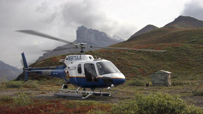 This 2008 image provided by the Alaska State Troopers shows their helicopter which crashed Saturday night March 30, 2013 while attempting to rescue a snowmobiler near Larson Lake 7 miles east of Talkeetna, Alaska. All three aboard are feared dead. (AP Photo/Alaska State Troopers)