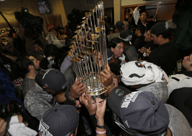 The San Francisco Giants players hold the Commissioner's Trophy after defeating the Detroit Tigers, 4-3, in Game 4 of baseball's World Series Monday, Oct. 29, 2012, in Detroit. The Giants won the series 4-0. (AP Photo/David J. Phillip)
