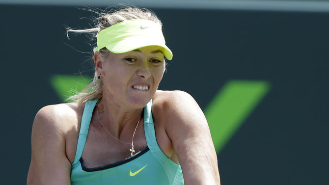 Maria Sharapova, of Russia, returns to Sara Errani, of Italy, during the quarterfinals of the Sony Open tennis tournament, Wednesday, March 27, 2013, in Key Biscayne, Fla. (AP Photo/Lynne Sladky)