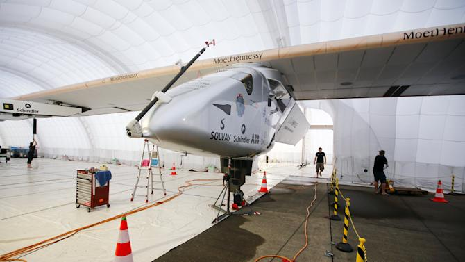 Solar powered plane Solar Impulse 2 is parked in inflatable hangar at Nagoya airport