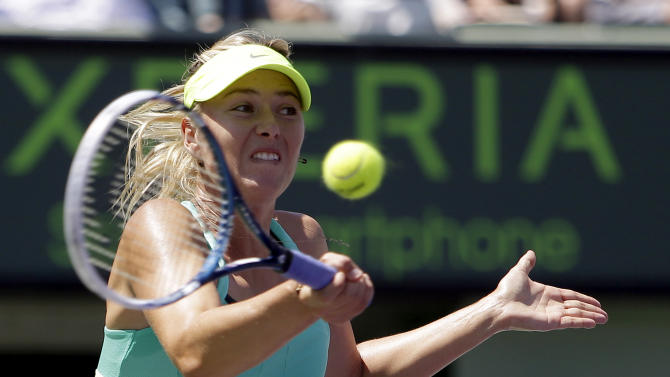 Maria Sharapova, of Russia, returns a shot from Serena Williams during the final match of the Sony Open tennis tournament, Saturday, March 30, 2013, in Key Biscayne, Fla. (AP Photo/Lynne Sladky)