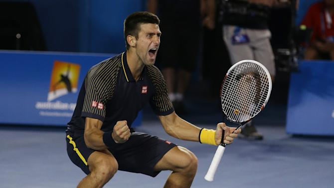 Serbia's Novak Djokovic celebrates his win over Britain's Andy Murray in the men's final at the Australian Open tennis championship in Melbourne, Australia, Sunday, Jan. 27, 2013. (AP Photo/Aaron Favila)