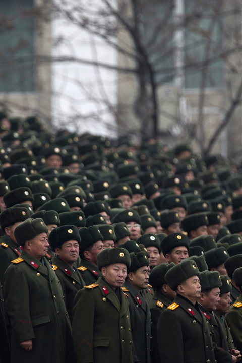 North Korean soldiers attend a mass rally organised to celebrate the success of a rocket launch that sent a satellite into space at Kim Il Sung Square in Pyongyang, North Korea, Friday, Dec. 14, 2012.