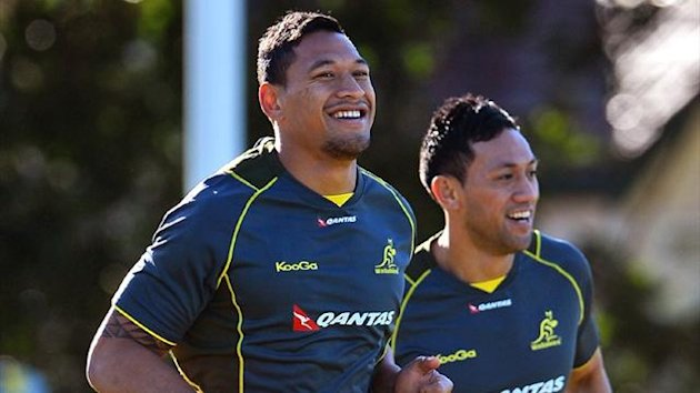 Wallabies fullback Israel Folau (L) and teammate Christian Leali'ifano (AFP)