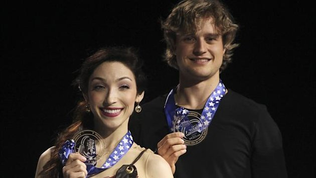 Pairs overall gold medal winners Meryl Davis (L) and Charlie White of the U.S. hold their medals up while on the winners podium at the Hilton HHonors Skate America in Kent, Washington (Reuters)