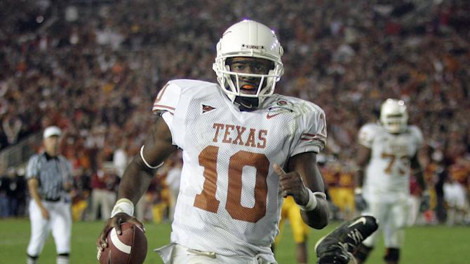 FILE - In this Jan. 6, 2006, file photo, Texas quarterback Vince Young rushes for the game-winning touchdown against Southern California in the national championship NCAA college football game at the Rose Bowl in Pasadena, Calif. Texas won the game 41-38. The 2006 game was on in nearly 22 percent of American homes with televisions; the second-best number is under 18 percent. Now, seven years later, the Notre Dame-Alabama matchup may finally challenge that Rose Bowl's TV ratings record. (AP Photo/Paul Sakuma, File)