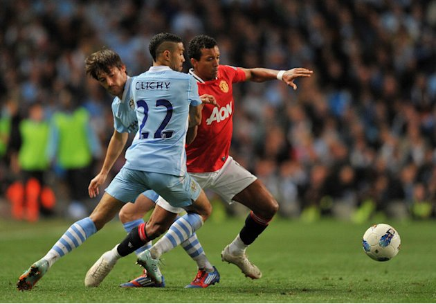 Manchester United's Portuguese Midfielder Nani (R) Vies For The Ball Against Manchester City's Spanish Footballer David AFP/Getty Images