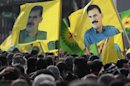 Demonstrators hold flags with portraits of jailed PKK leader Abdullah Ocalan in Strasbourg