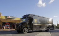 FILE - In this Monday, Jan. 28, 2013, file photo, a UPS truck arrives for a delivery Miami Springs, Fla. United Parcel Service Inc. reports quarterly earnings on Friday, Oct. 25, 2013. (AP Photo/Alan Diaz, File)