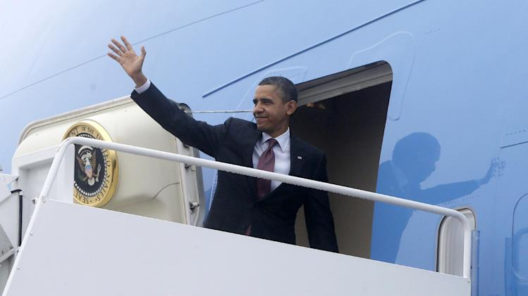 President Barack Obama turns and waves as he boards Air Force One at Andrews Air Force Base, Md., Monday, Dec. 10, 2012, as he travels to Michigan to visit the Daimler Detroit Diesel plant in Redford, Mich. (AP Photo/Charles Dharapak)