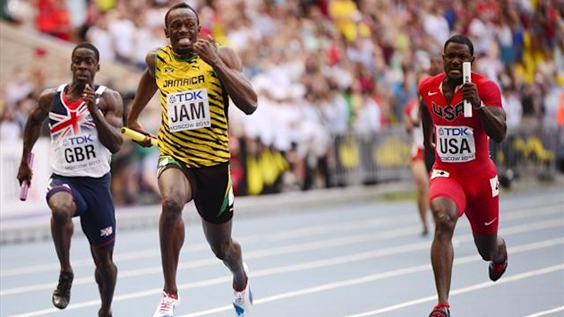 Jamaica's Usain Bolt (C) crosses the finish line ahead of Britain's Dwain Chambers (L) and USA's Justin Gatlin (R) during the men's 4x100 metres relay final at the 2013 IAAF World Championships at the Luzhniki stadium in Moscow on August 18, 2013. AFP