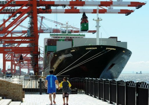 <p>A cargo ship is docked at an international cargo terminal in Tokyo. Japan's current account surplus dropped 40.6 percent in July due to an expansion in its trade deficit, official data showed Monday.</p>