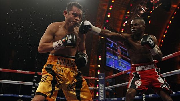 Cuban boxer Guillermo Rigondeaux (R) connects a punch on Nonito Donaire of Philippines during their WBO/WBA junior featherweight title unification fight at Radio City Music Hall in New York