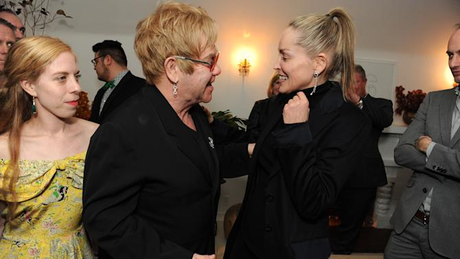 """Sharon Stone, right, and Elton John attend LoveGold/EJAF Celebrate """"How to Survive a Plague"""" at Chateau Marmont on February 22, 2013 in Los Angeles. (Photo by Jordan Strauss/Invision for LoveGold/AP Images)"""