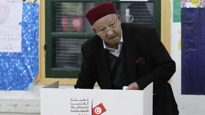 Man casts his vote at a polling station during Tunisia's presidential election in Sousse