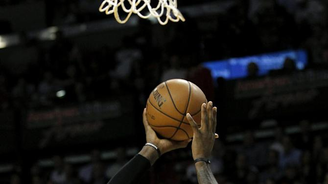 Miami Heat's LeBron James (6) shoots over New York Knicks' J.R. Smith (8) in the first half of an NBA basketball game, Thursday, Dec, 6, 2012, in Miami. ( AP Photo/Alan Diaz)