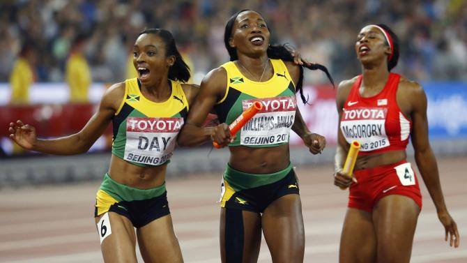 Christine Day of Jamaica and teammate Novlene Williams-Mills celebrate after crossing the finish line in the women's 4 x 400 metres relay final during the 15th IAAF World Championships at the National Stadium in Beijing