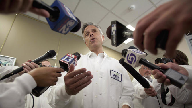 Republican presidential candidate, former Utah Gov. Jon Huntsman talks to the media during his tour of Nelson Laboratories in Taylorsville, Utah, Tuesday June 28, 2011. Huntsman toured the lab and meet the staff during a campaign stop in Utah. (AP Photo/Jim Urquhart)