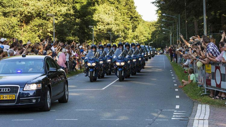A motorcade accompanies a row of hearses carrying the bodies of victims killed in Malaysia Airlines Flight MH17 plane disaster arrives at the Korporaal van Oudheusden barracks in Hilversum