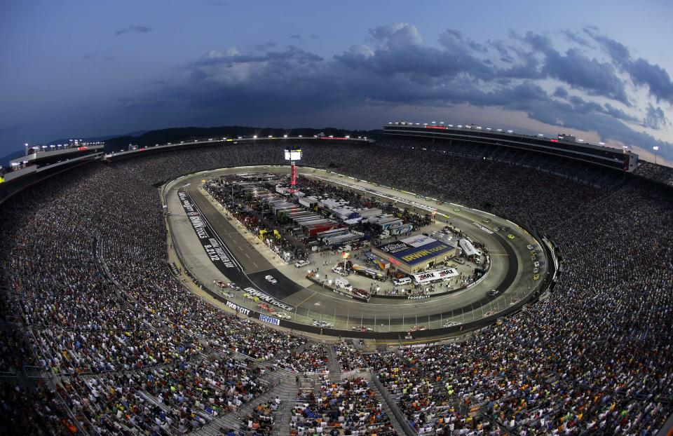 Fans watch the NASCAR Sprint Cup Series auto race Saturday, Aug. 25, 2012, in Bristol, Tenn. (AP Photo/Mark Humphrey)