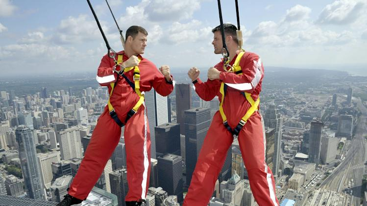 COMMERCIAL IMAGE - In this photograph provided by The Canadian Press Images/Ultimate Fighting Championship, UFC fighters Michael Bisping, left, and Brian Stann square off while hanging off the CN Tower's EdgeWalk, Tuesday, July 24, 2012, as tickets for their September 22 Toronto event go on sale July 27. ( The Canadian Press Images Photo/Ultimate Fighting Championship)