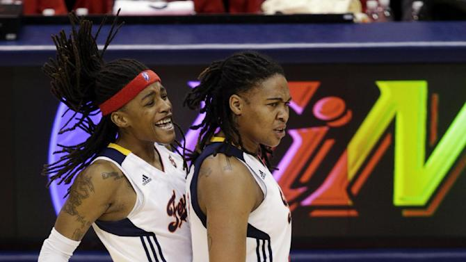 Indiana Fever guard Shavonte Zellous, left, congratulates Erlana Larkins on being fouled in the second half of Game 4 of the WNBA basketball Finals against the Minnesota Lynx, Sunday, Oct. 21, 2012, in Indianapolis. (AP Photo/AJ Mast)