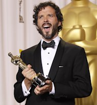 "FILE - In this Feb. 26, 2012 file photo, Bret McKenzie poses with his award for best original song for ""Man or Muppet"" during the 84th Academy Awards in the Hollywood section of Los Angeles. The motion-picture academy said Thursday, Aug. 30, 2012 that there will be a minimum of five nominees in the original song category at the 85th annual Academy Awards on Feb. 24, 2013. (AP Photo/Joel Ryan, File)"