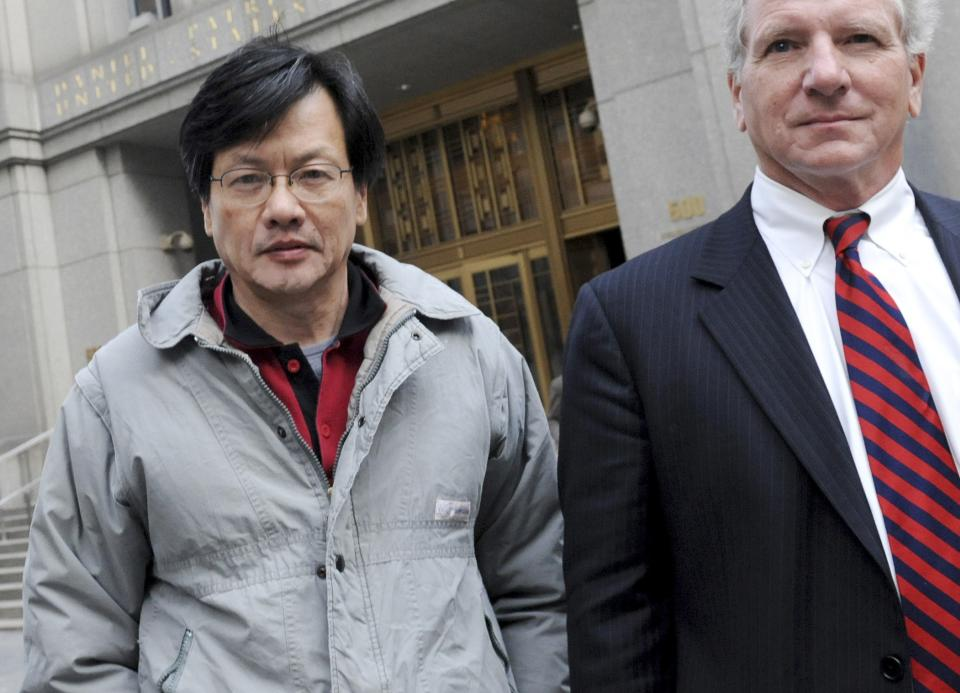 FILE - In this file photo taken Nov. 24, 2010, Don Ching Trang Chu, left, exits Manhattan federal court in New York with his lawyer James DeVita. Chu, a consulting firm executive, was arrested Wednesday for allegedly providing private information about a company's corporate earnings to a hedge fund. (AP Photo/ Louis Lanzano, File)