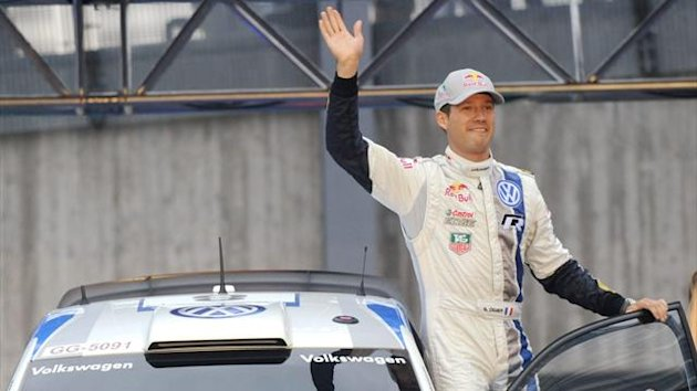 Sebastien Ogier waves (Reuters)