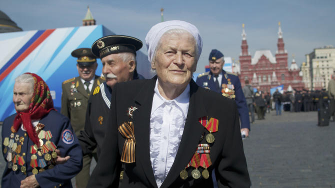 Russian WWII veterans walk after a Victory Day parade at Red Square on Thursday, May 9, 2013. President Vladimir Putin said at the annual military parade hat Russia will be a guarantor of world security. Putin's short speech came at the culmination of Victory Day, marking the defeat of Nazi Germany 68 years ago. It is Russia's most important secular holiday, honoring the huge military and civilian losses of World War II and showing off the country's modern arsenal. (AP Photo/Ivan Sekretarev)