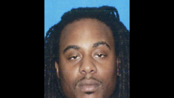 """This April 2011 photo from the California Department of Motor Vehicles shows Kenneth Cherry Jr., also known as rapper """"Kenny Clutch."""" The Clark County, Nev., coroner's office identified Cherry as the Maserati driver who died Thursday, Feb. 21, 2013 after being peppered with gunfire from someone in a Range Rover SUV, sparking a fiery crash that killed two others in Las Vegas. (AP Photo/California DMV)"""