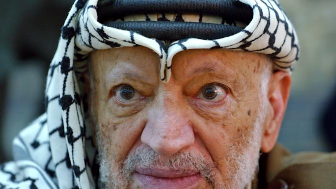FILE - In this Saturday, Oct. 2, 2004 file photo, Palestinian leader Yasser Arafat pauses during an emergency cabinet session at his compound in the West Bank town of Ramallah. A Russian probe into the death of Palestinian leader Yasser Arafat has found no trace of radioactive poisoning, the chief of the government agency that conducted the study said Thursday, Dec. 26, 2013. (AP Photo/Muhammed Muheisen, File)