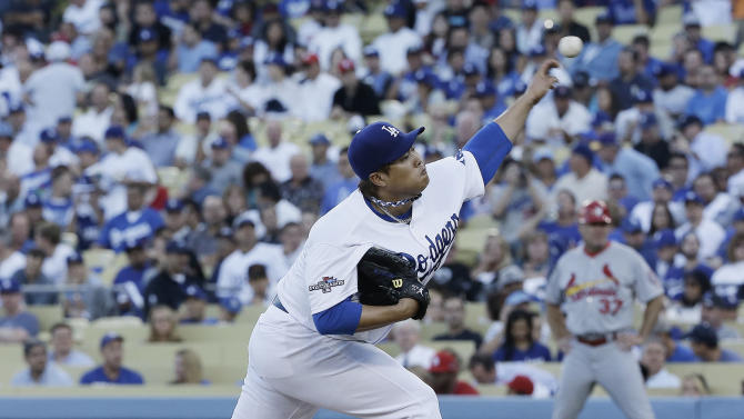Los Angeles Dodgers starting pitcher Hyun-Jin Ryu throws during the second inning of Game 3 of the National League baseball championship series against the St. Louis Cardinals Monday, Oct. 14, 2013, in Los Angeles. (AP Photo/David J. Phillip)