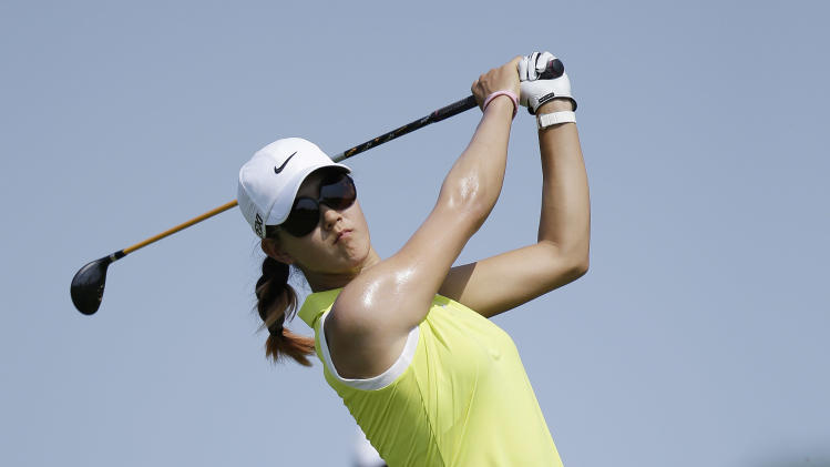 Michelle Wie drives off the fifth tee during the first round of the U.S. Women's Open golf tournament on Thursday, July 5, 2012, in Kohler, Wis. (AP Photo/Julie Jacobson)